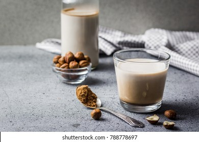 """Raw """"nutella"""" milk in a glass. Selective focus, copy space, close up."""