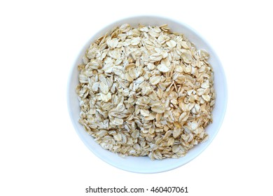 Raw oatmeal flakes in white bowl isolated on white background