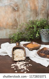 Raw Oatmeal in Wood Scoop, Brown Coconut Sugar and Mini Chocolate Chips in Wooden Bowls, Wood Table