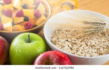 Raw oats in bowl and fruit