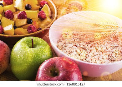 Raw oats in bowl and fruit salad