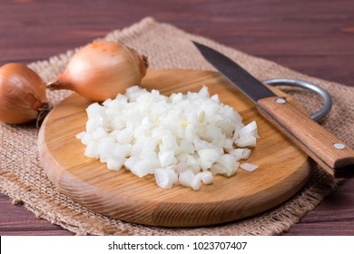 Raw onion, chopped very small cubes on a board