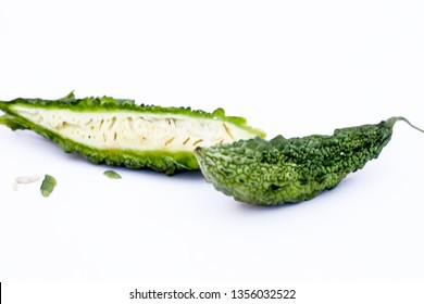 Raw organic bitter melon or Bitter Cucumber or Bitter Gourd isolated on white.