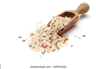 Raw organic brown rice in wooden scoop