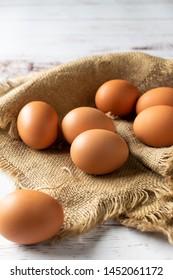 Raw organic chicken eggs on a light background
