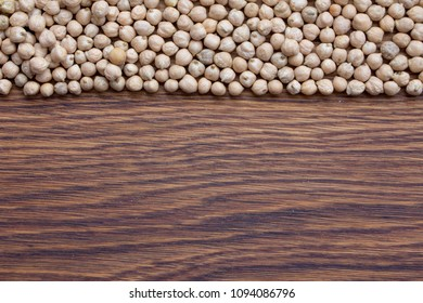 raw organic chickpeas in a wooden plate Natural organic bean