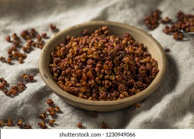 Raw Organic Dry Szechuan Peppercorns in a Bowl
