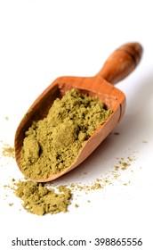 raw organic hemp protein powder on white