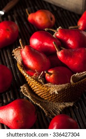 Raw Organic Red Pears in a Basket