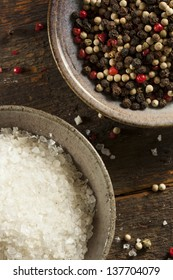 Raw Organic Sea Salt and Pepper against a background