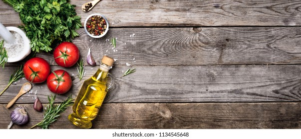 Raw organic vegetables with fresh ingredients for healthily cooking on vintage background, top view, banner. Vegan or diet food concept. Background layout with free text space