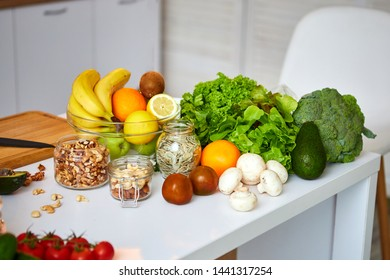 Raw organic vegetables, fruits and nuts with fresh ingredients for healthily cooking on kitchen. Vegan or diet food concept. Healthy Lifestyle and Eating