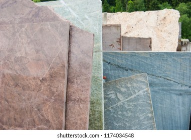 Raw and overlapping Carrara marble slabs outside