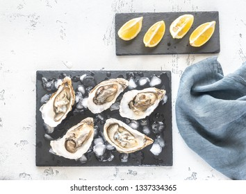 Raw oysters on the slate board flat lay