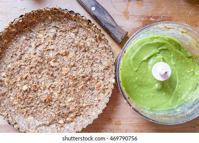 Raw Paleo Healthy Green Avocado Cake Preparation Process, Lemon-Avocado Cream inside Mixer, Healthy Food Concept, Top View