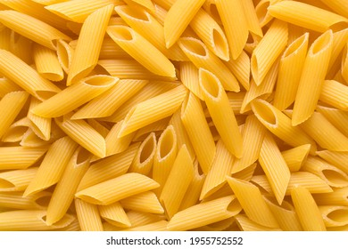 Raw Pasta Penne food background. Italian food. Top view.