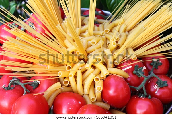 Raw pasta and tomatoes