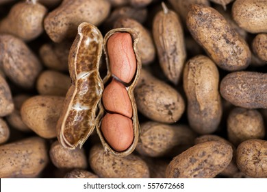 Raw peanuts in the shell background or texture. close up peanut top view.