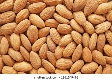 Raw peeled almond seeds background,almond nut is unsaturated fat food benefit for decrease blood cholesterol and good nutrition for diet and lost weight.