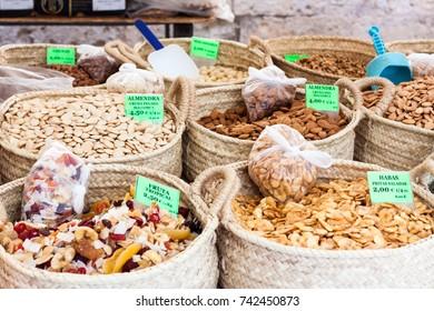 Raw peeled almonds (almendra cruda pelada), dried tropical fruits (fruta tropical), raw almonds with skin (almendra cruda piel) and fried salted broad beans (habas fritas saladas). Sineu, Majorca