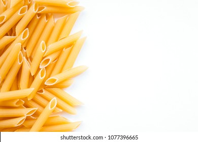 Raw penne rigate pasta backgroung. Flatlay style, top view. Traditional italian cuisine.