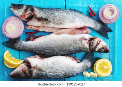 Raw pike perch whole fish with vegetables