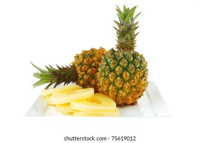 raw pineapples and slices served on plate