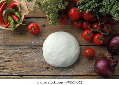 Raw pizza rustic background