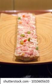 Raw Polish zapiekanka with ham.