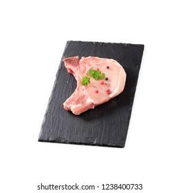 raw pork chop on white background