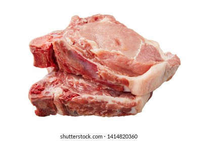 Raw pork loin isolated on white background. Raw fresh pork fillet steak with the bone. Sliced raw pork meat isolated.
