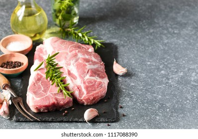 Raw pork meat for grill with ingredients for cooking, copy space