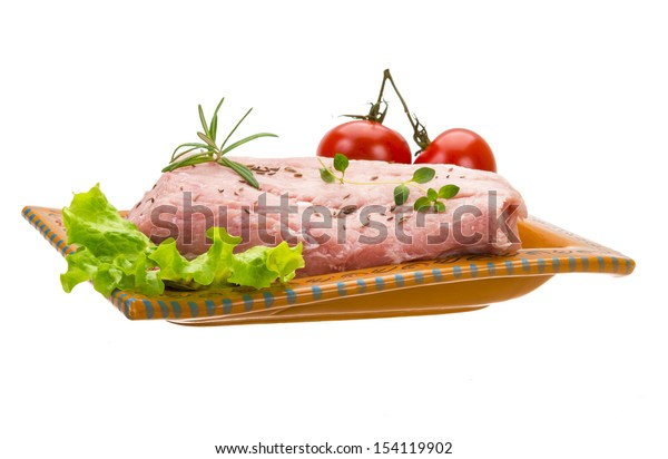 Raw pork meat isolated with rosemary and herbs