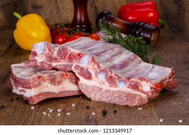 Raw pork meat over wooden background