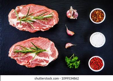 Raw pork on black stone