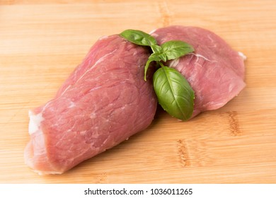 raw pork on a wooden background