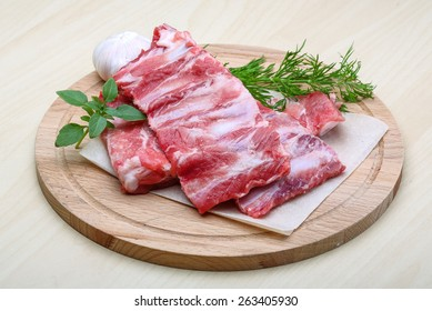 Raw pork ribs with dill - ready for cooking