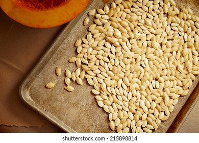 Raw pumpkins seeds and pumpkin.