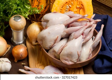 Raw quails, onions, garlic, lettuce, olive oil and butternut squash