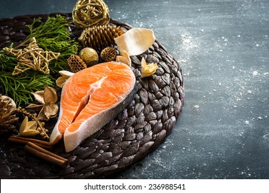 raw red fish with Christmas decorations