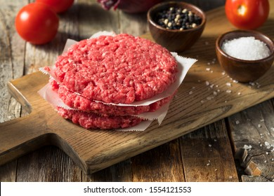 Raw Red Organic Hamuburger Pattys Ready to Cook