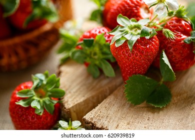 raw red strawberries on rustic table