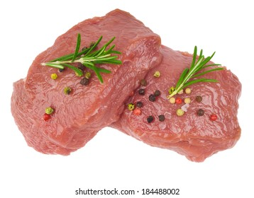 Raw ribeye steak garnished with a sprig of rosemary