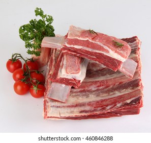 raw ribs  on White Background  and vegetables