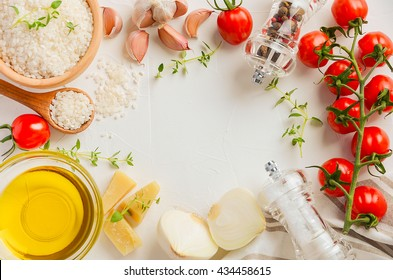 Raw rice and ingredients for cooking risotto, top view, copy space
