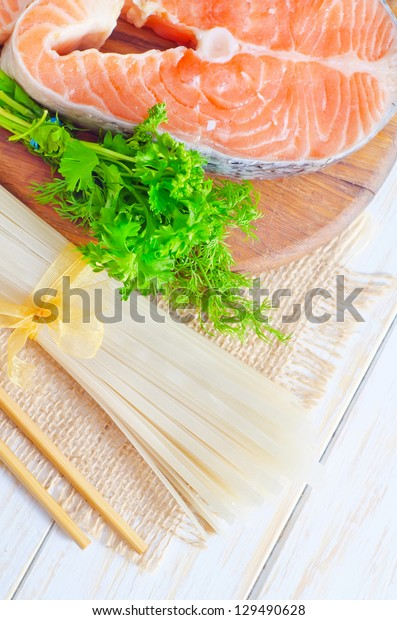 raw rice noodles and raw salmon