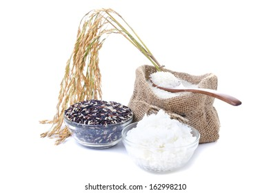 Raw rice, Selection Of black rice white rice and white steamed rice with wood spoon .