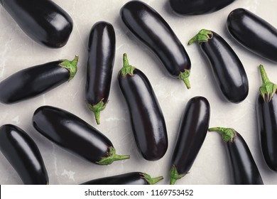 Raw ripe eggplants on light background, top view