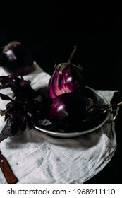 Raw round eggplant on a plate. Eggplant variety Helios