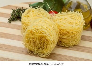 Raw Round vermicelli on the wood background